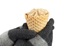 Hands in knitted gloves keep ice cream isolated on white Royalty Free Stock Photo