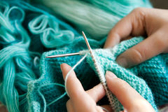 Hands knitting Stock Images
