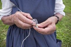 Hands knitting Stock Image