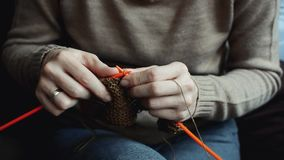 Hands with knitting needles in close up stock video