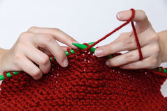 Hands knitting a re muffler Royalty Free Stock Photo