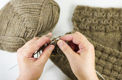 Handmade. Hands knitting royalty free stock image