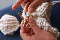 Hands Knitting with Yarn Stock Images