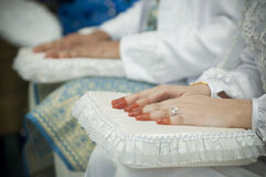 Hands on Laps. Bride's and groom's hands on laps during wedding reception ceremony Royalty Free Stock Photography