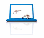 Hands and laptop. Artificial intelligence - a laptop programming itself - Ghost in the machine Royalty Free Stock Photography