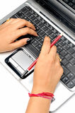 Hands on laptop. With pencil Royalty Free Stock Images