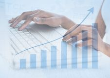 Hands on laptop with blue graph overlay Stock Photography