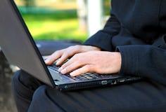 Hands on Laptop closeup Stock Photos