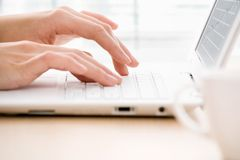 Hands and laptop. Human hands over laptop keypad during typing Stock Photos