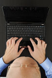 Hands on the laptop keyboard. Stock Photo