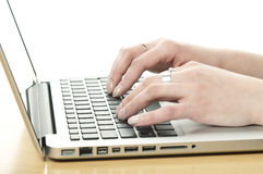 Hands on the laptop keyboard Royalty Free Stock Photos