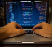 Hands on laptop keyboard. Man on coding royalty free stock photo
