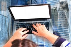 Hands on laptop keyboard Stock Image