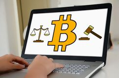 Bitcoin regulation concept on a laptop screen. Hands on a laptop with screen showing bitcoin regulation concept royalty free stock images