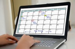 Planner concept on a laptop screen. Hands on a laptop with screen showing planner concept Royalty Free Stock Images