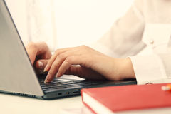 Hands and laptop. On white background. Woman hands and laptop against white background Royalty Free Stock Photo