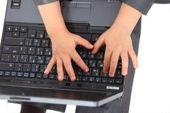 Hands on laptpop`s keyboard Stock Image