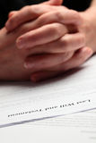 Hands and Last Will. An elderly woman's hands waiting to sign a last will document Royalty Free Stock Images