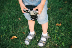 Little boy holding a film camera Royalty Free Stock Image