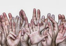 Hands lifted upwards royalty free stock image