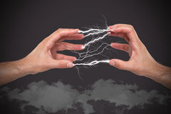 Hands with lightning in the fingers Royalty Free Stock Photos