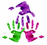 Hands linked through the fingers. Multi-coloured finger painted hands linked through the fingers Stock Image