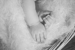 Hands of little baby in basket Royalty Free Stock Photos