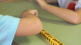 Hands of little boys studying numbers and letters. Hands of little boys touching special learning symbols and studying numbers and letters during school lesson stock video