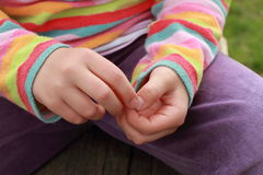 Hands of a little girl. Playing with something royalty free stock photo