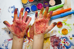 Hands of little girl by the painting Royalty Free Stock Image