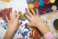 Hands of little girl by the painting Royalty Free Stock Photography