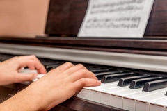 Hands of a little girl playing the piano Royalty Free Stock Images