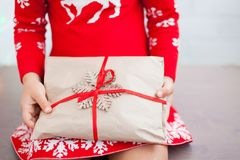 Hands of little girl is holding Christmas gift royalty free stock image