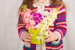 Hands of a little girl with spring flowers Stock Images
