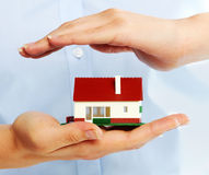 Hands with little house. Stock Photo