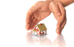 Hands and little house. Royalty Free Stock Photo