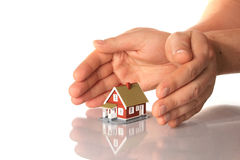 Hands and little house. stock images