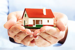 Hands with little house. Royalty Free Stock Photos
