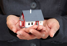 Hands with little house. Stock Photography