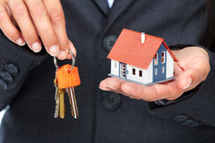 Hands with little house. Stock Images