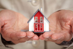 Hands with little house. Royalty Free Stock Photography