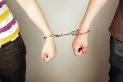 Hands locked with handcuffs. Hands locked together with handcuffs Stock Image