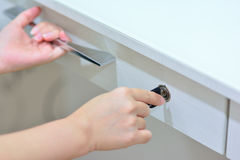 Hands locking and checking  drawer Stock Images