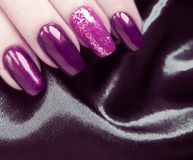 Hands long manicure silk fabric glamour black polish, beauty fashion. Hands manicure long silk fabric salon polish, fashion beauty glamour royalty free stock images