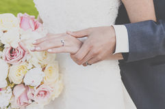 Hands in love. Bride and groom holding love in their hands Royalty Free Stock Photo