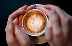 Hands of love and a cup of coffee Royalty Free Stock Photos
