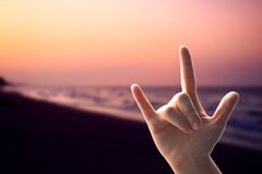 Hands love sign on sunset beach Stock Photography