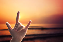 Hands love sign on sunset beach Royalty Free Stock Image