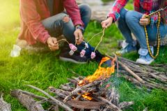 Hands of lover roasting marshmallows stock photography
