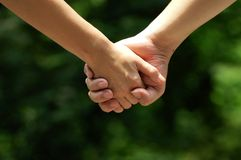 Hands of lovers. Two lovers are walking  hand in hand Royalty Free Stock Images